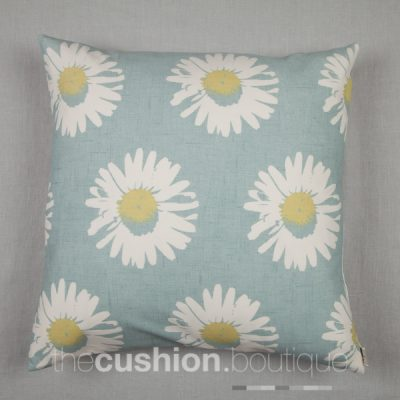 Large modern daisies on a chalky blue background