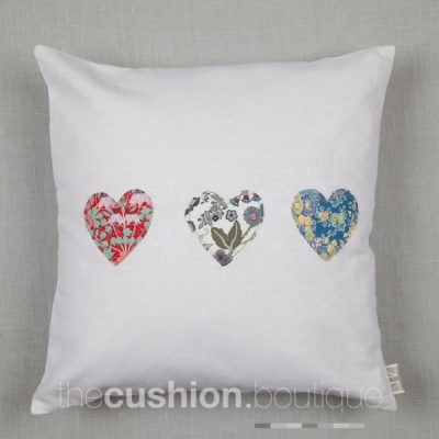 Classic white Linen handmade cushion embellished with Liberty print small hearts