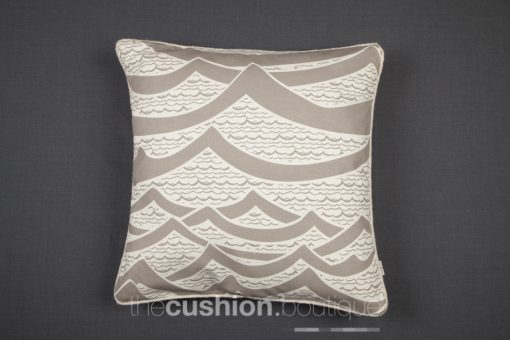 Cushion featuring handprinted waves with felt piping