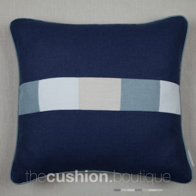French Navy handmade linen cushion with patchwork central band in shades of blue & grey
