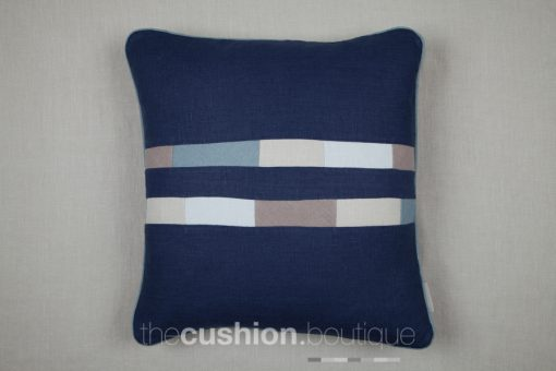 Shades of blue and grey patchwork tiles in stonewashed linen handmade cushion