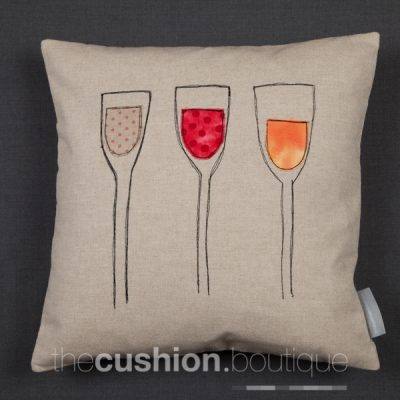 Handmade linen cushion featuring red, white & rosé fabric free machine embroidered wine glasses